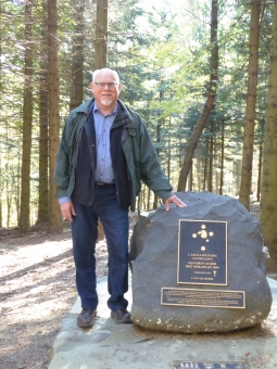 Darryl Dymock with memorial stone